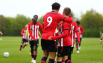 NORWICH, ENGLAND - APRIL 27: Kornelius Hansen scores and celebrates (right) with Christian Norton (left) during a U18 Premier League match between Norwich City FC and Southampton FC pictured at Colney Training Ground on April 27, 2019 in Norwich, England. (Photo by James Bridle - Southampton FC/Southampton FC via Getty Images)