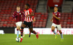 SOUTHAMPTON, ENGLAND - MAY 03: Dan Nlundulu  (left) during the U23s PL2 Play off Semi-Final between Southampton FC and Aston Villa FC pictured at St Mary's Stadium on May 03, 2019 in Southampton, England. (Photo by James Bridle - Southampton FC/Southampton FC via Getty Images)