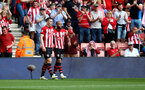 SOUTHAMPTON, ENGLAND - MAY 12: Pierre-Emile Hojbjerg(L) and Nathan Redmond during the Premier League match between Southampton FC and Huddersfield Town at St Mary's Stadium on May 12, 2019 in Southampton, United Kingdom. (Photo by Matt Watson/Southampton FC via Getty Images)