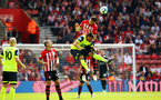 SOUTHAMPTON, ENGLAND - MAY 12: Jan Bednarek jumps for a header (middle) during the Premier League match between Southampton FC and Huddersfield Town at St Mary's Stadium on May 12, 2019 in Southampton, United Kingdom. (Photo by James Bridle - Southampton FC/Southampton FC via Getty Images)