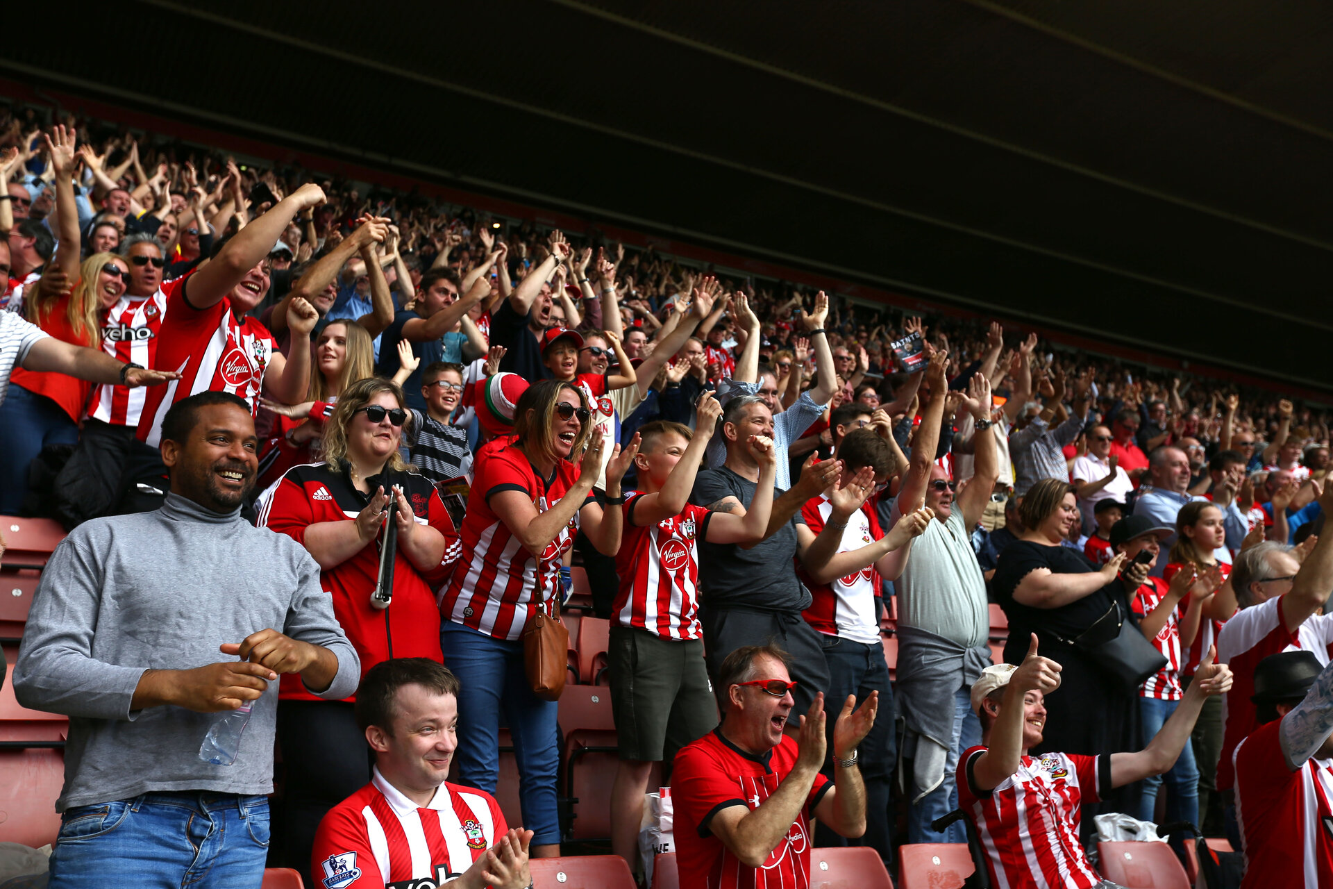SOUTHAMPTON, ENGLAND - MAY 12: Nathan Redmond scores and fans celebrate during the Premier League match between Southampton FC and Huddersfield Town at St Mary's Stadium on May 12, 2019 in Southampton, United Kingdom. (Photo by James Bridle - Southampton FC/Southampton FC via Getty Images)