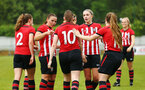 SOUTHAMPTON, ENGLAND - MAY 19: Ella Pusey (middle)  scores and celebrated with the team during the Womens Cup Final match between Southampton FC and Oxford pictured at AFC Totten on May 19, 2019 in Southampton, England. (Photo by James Bridle - Southampton FC/Southampton FC via Getty Images)
