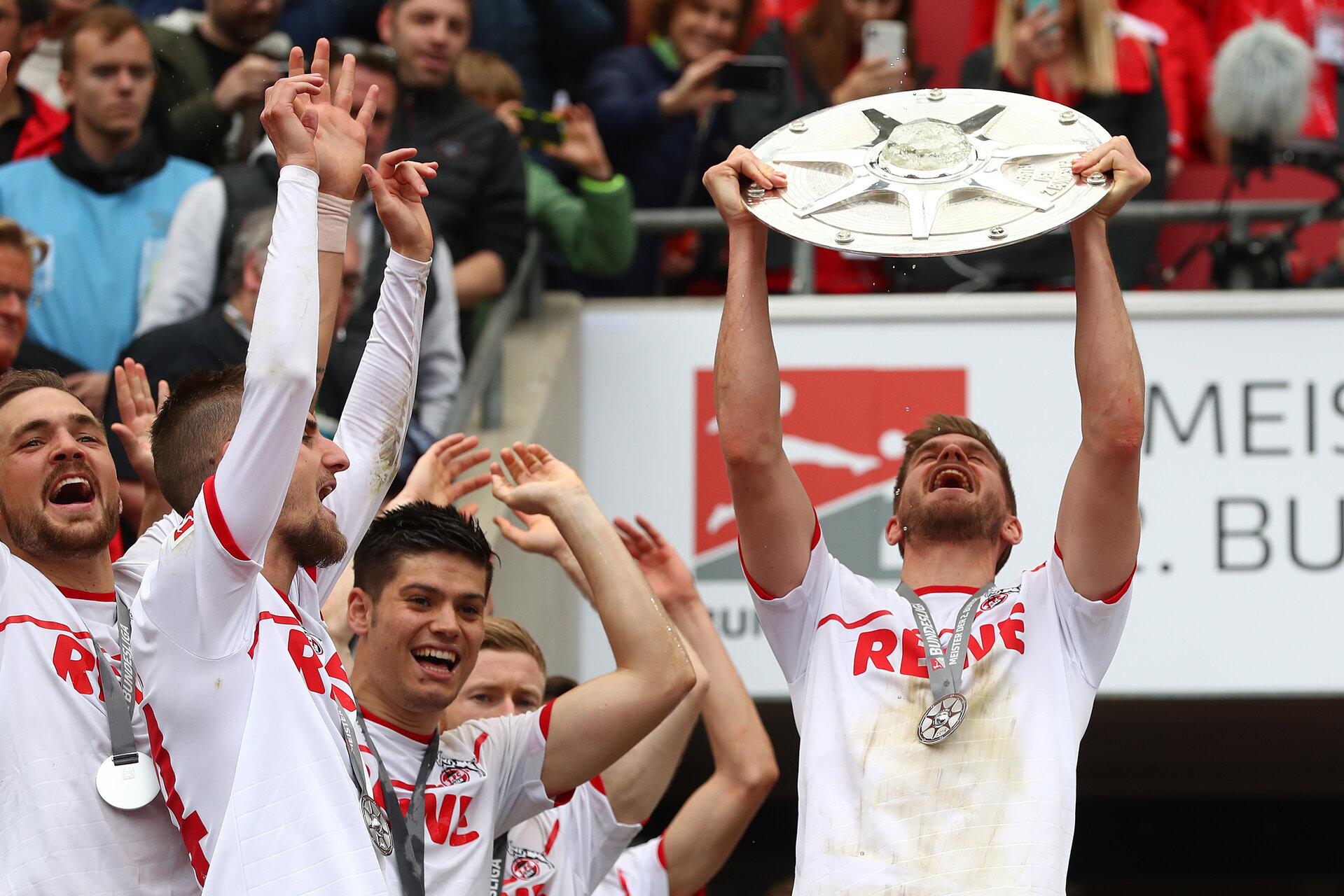 COLOGNE, GERMANY - MAY 12: Simon Terodde of FC Koeln celebrates with the Second Bundesliga trophy at the end of the Second Bundesliga match between 1. FC Koeln and SSV Jahn Regensburg at RheinEnergieStadion on May 12, 2019 in Cologne, Germany. (Photo by Lars Baron/Bongarts/Getty Images)