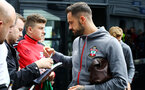 PRESTON, ENGLAND - JULY 20: Danny Ings of Southampton (right) signs fan merchandise ahead of the pre-season friendly game between Preston North End and Southampton FC pictured at Deepdale on July 20, 2019 in Preston, England. (Photo by James Bridle - Southampton FC/Southampton FC via Getty Images)