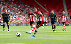 SOUTHAMPTON, ENGLAND - AUGUST 03: Danny Ings of Southampton scores from the penalty spot during the Pre-Season Friendly match between Southampton FC and FC Köln at St. Mary's Stadium on August 03, 2019 in Southampton, England. (Photo by Matt Watson/Southampton FC via Getty Images,)
