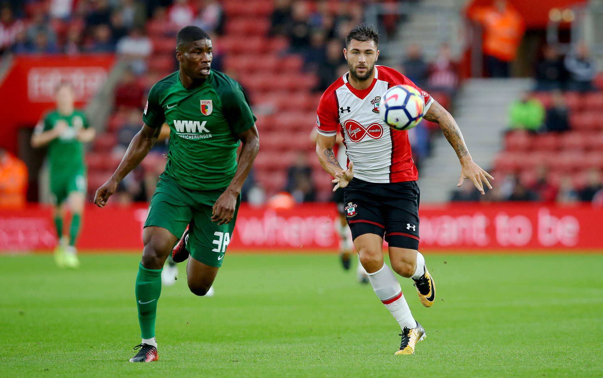 SOUTHAMPTON, ENGLAND - AUGUST 02: Kevin Danso(left) and Charlie Austin(right) during the pre-season friendly between Southampton FC and Augsburg at St Mary's Stadium on August 2, 2017 in Southampton, England. (Photo by Matt Watson/Southampton FC via Getty Images)