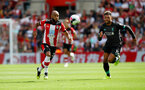 SOUTHAMPTON, ENGLAND - AUGUST 17: Nathan Redmond(L) of Southampton and Alex Oxlade-Chamberlain(R) of Liverpool during the Premier League match between Southampton FC and Liverpool FC at St Mary's Stadium on August 17, 2019 in Southampton, United Kingdom. (Photo by Matt Watson/Southampton FC via Getty Images)