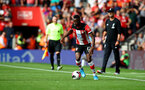 SOUTHAMPTON, ENGLAND - AUGUST 17: Moussa Djenepo of Southampton on the ball during the Premier League match between Southampton FC and Liverpool FC at St Mary's Stadium on August 17, 2019 in Southampton, United Kingdom. (Photo by Matt Watson/Southampton FC via Getty Images)
