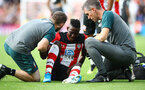 SOUTHAMPTON, ENGLAND - AUGUST 17: Moussa Djenepo of Southampton receives treatment during the Premier League match between Southampton FC and Liverpool FC at St Mary's Stadium on August 17, 2019 in Southampton, United Kingdom. (Photo by Matt Watson/Southampton FC via Getty Images)