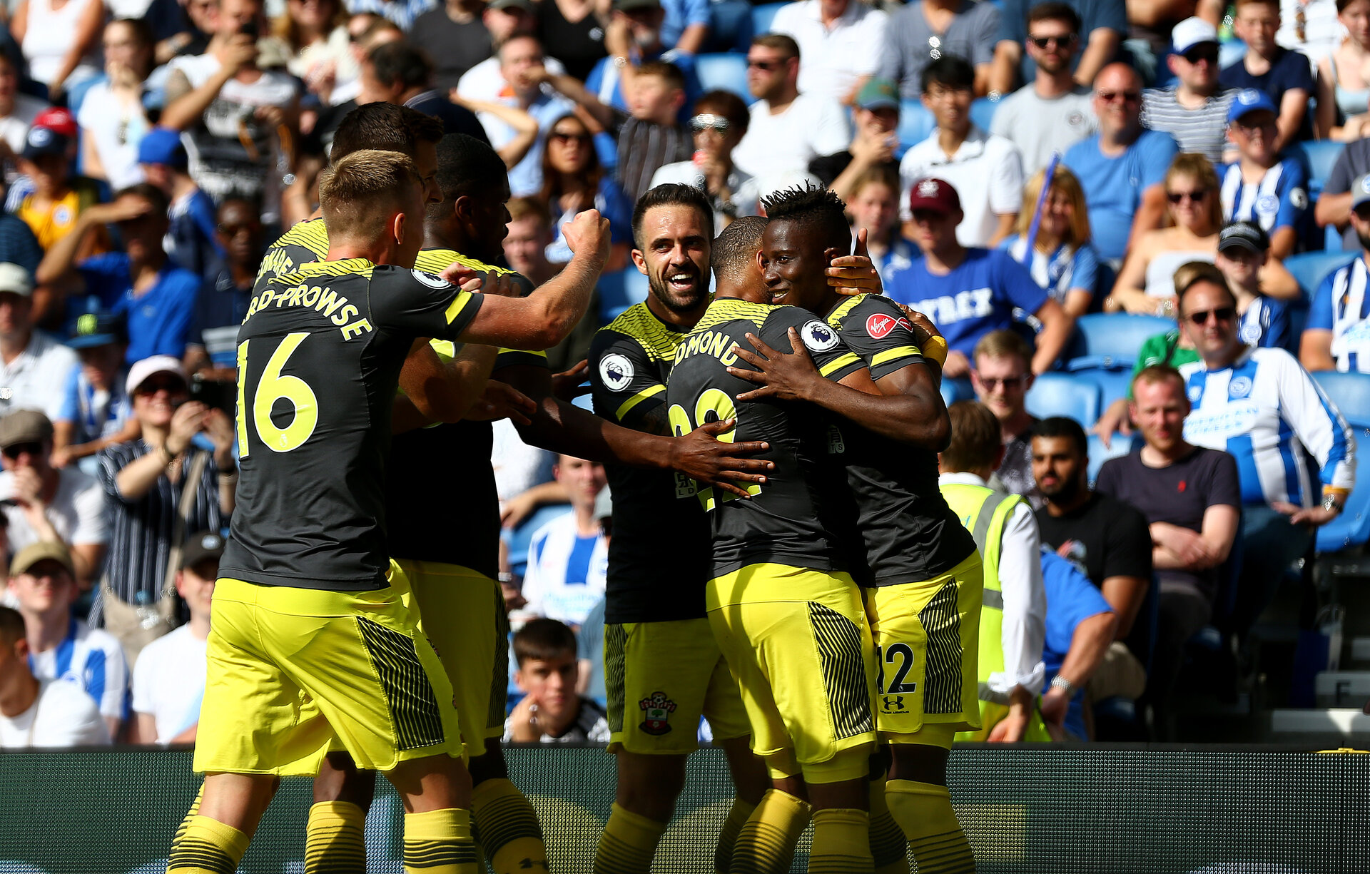 BRIGHTON, ENGLAND - AUGUST 24: Moussa Djenepo(12) of Southampton celebrates with his team mates after opening the scoring during the Premier League match between Brighton & Hove Albion and Southampton FC at American Express Community Stadium on August 24, 2019 in Brighton, United Kingdom. (Photo by Matt Watson/Southampton FC via Getty Images)