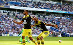 BRIGHTON, ENGLAND - AUGUST 24: Nathan Redmond(R) celebrates his goal with Sofiane Boufal(L) both of Southampton during the Premier League match between Brighton & Hove Albion and Southampton FC at American Express Community Stadium on August 24, 2019 in Brighton, United Kingdom. (Photo by Matt Watson/Southampton FC via Getty Images)