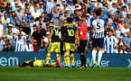BRIGHTON, ENGLAND - AUGUST 24: Yan Valery of Southampton down injured as Brighton's Neal Maupay is shown a red card during the Premier League match between Brighton & Hove Albion and Southampton FC at American Express Community Stadium on August 24, 2019 in Brighton, United Kingdom. (Photo by Matt Watson/Southampton FC via Getty Images)