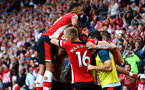 SOUTHAMPTON, ENGLAND - AUGUST 31: Sofiane Boufal of Southampton celebrates with his team mates during the Premier League match between Southampton FC and Manchester United at St Mary's Stadium on August 31, 2019 in Southampton, United Kingdom. (Photo by Matt Watson/Southampton FC via Getty Images)