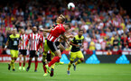 SHEFFIELD, ENGLAND - SEPTEMBER 14: James Ward-Prowse)L) of Southampton and Jack O'Connell of Sheffield United during the Premier League match between Sheffield United and Southampton FC at Bramall Lane on September 14, 2019 in Sheffield, United Kingdom. (Photo by Matt Watson/Southampton FC via Getty Images)