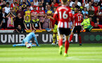 SHEFFIELD, ENGLAND - SEPTEMBER 14: Angus Gunn of Southampton saves with his legs during the Premier League match between Sheffield United and Southampton FC at Bramall Lane on September 14, 2019 in Sheffield, United Kingdom. (Photo by Matt Watson/Southampton FC via Getty Images)