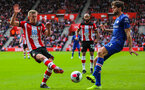 SOUTHAMPTON, ENGLAND - OCTOBER 6: James Ward-Prowse of Southampton FC and Marcos Alonso of Chelsea FC battle for possession during the Premier League match between Southampton FC and Chelsea FC at St Mary's Stadium on October 6, 2019 in Southampton, England