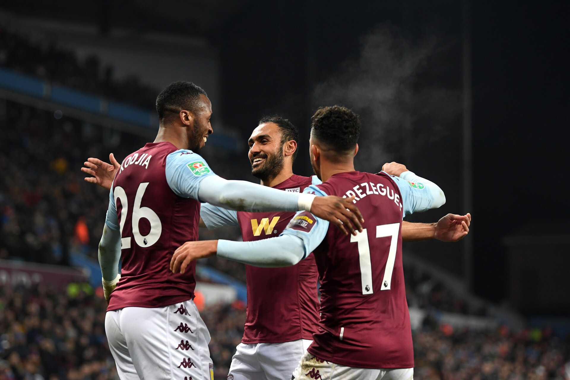 BIRMINGHAM, ENGLAND - DECEMBER 17: Jonathan Kodija of Aston Villa celebrates after scoring his team's fourth goal with Ahmed Elmohamady and Mahmoud Hassan during the Carabao Cup Quarter Final match between Aston Villa and Liverpool FC at Villa Park on December 17, 2019 in Birmingham, England. (Photo by Michael Regan/Getty Images)