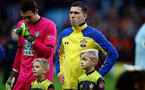 BIRMINGHAM, ENGLAND - DECEMBER 21: Pierre-Emile Hojbjerg of Southampton with the match day mascots during the Premier League match between Aston Villa and Southampton FC at Villa Park on December 21, 2019 in Birmingham, United Kingdom. (Photo by Matt Watson/Southampton FC via Getty Images)