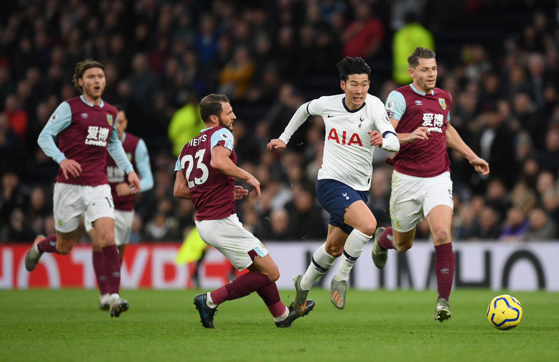 LONDON, ENGLAND - DECEMBER 07:  Heung-Min Son of Tottenham Hotspur breaks past Erik Pieters of Burnley to go on and score his team's third goal during the Premier League match between Tottenham Hotspur and Burnley FC at Tottenham Hotspur Stadium on December 07, 2019 in London, United Kingdom. (Photo by Shaun Botterill/Getty Images)