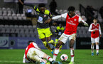 BOREHAMWOOD, ENGLAND - JANUARY 09: Kazeem Olaigbe of Southampton FC (C) is tackled during the FA Youth Cup Fourth Round match between Arsenal U18s and Southampton FC U18s at Meadow Park on January 09, 2020 in Borehamwood, England