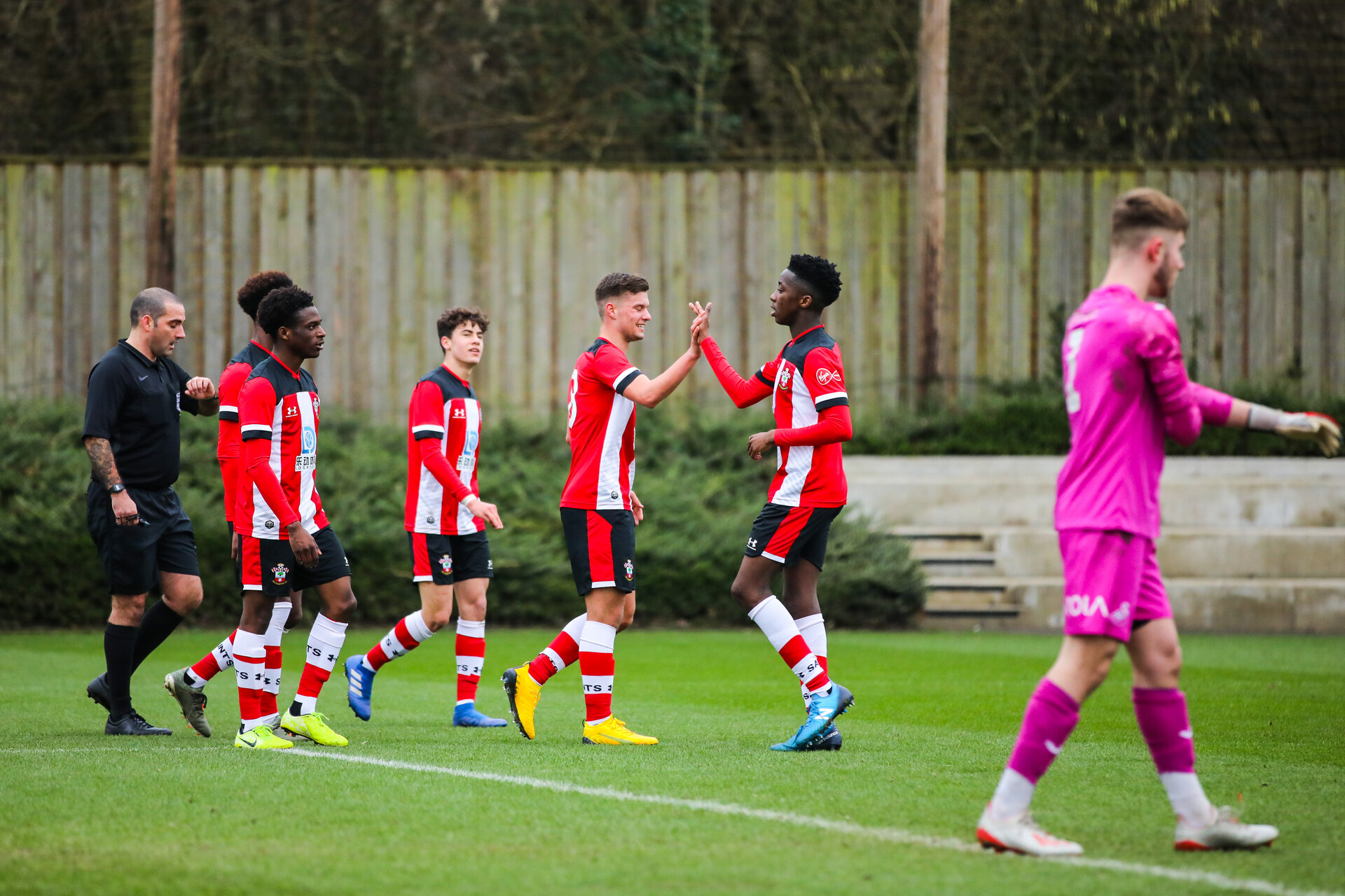 SOUTHAMPTON, ENGLAND - JANUARY 23: Jack Turner of Southampton FC celebrates with teammates after scoring his second goal and his side's third goal during the Barclays Under 18 Premier League match between Southampton FC and Swansea City at the Staplewood Campus on January 23, 2020 in Southampton, England