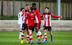 SOUTHAMPTON, ENGLAND - JANUARY 23: Seamas Keogh of Southampton FC (C, #2) celebrates with teammates after scoring his side's first goal during the Barclays Under 18 Premier League match between Southampton FC and Swansea City at the Staplewood Campus on January 23, 2020 in Southampton, England