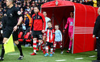 SOUTHAMPTON, ENGLAND - FEBRUARY 22: Pierre-Emile Højbjerg of Southampton leads the teams out with the match day mascot during the Premier League match between Southampton FC and Aston Villa at St Mary's Stadium on February 22, 2020 in Southampton, United Kingdom. (Photo by Matt Watson/Southampton FC via Getty Images)