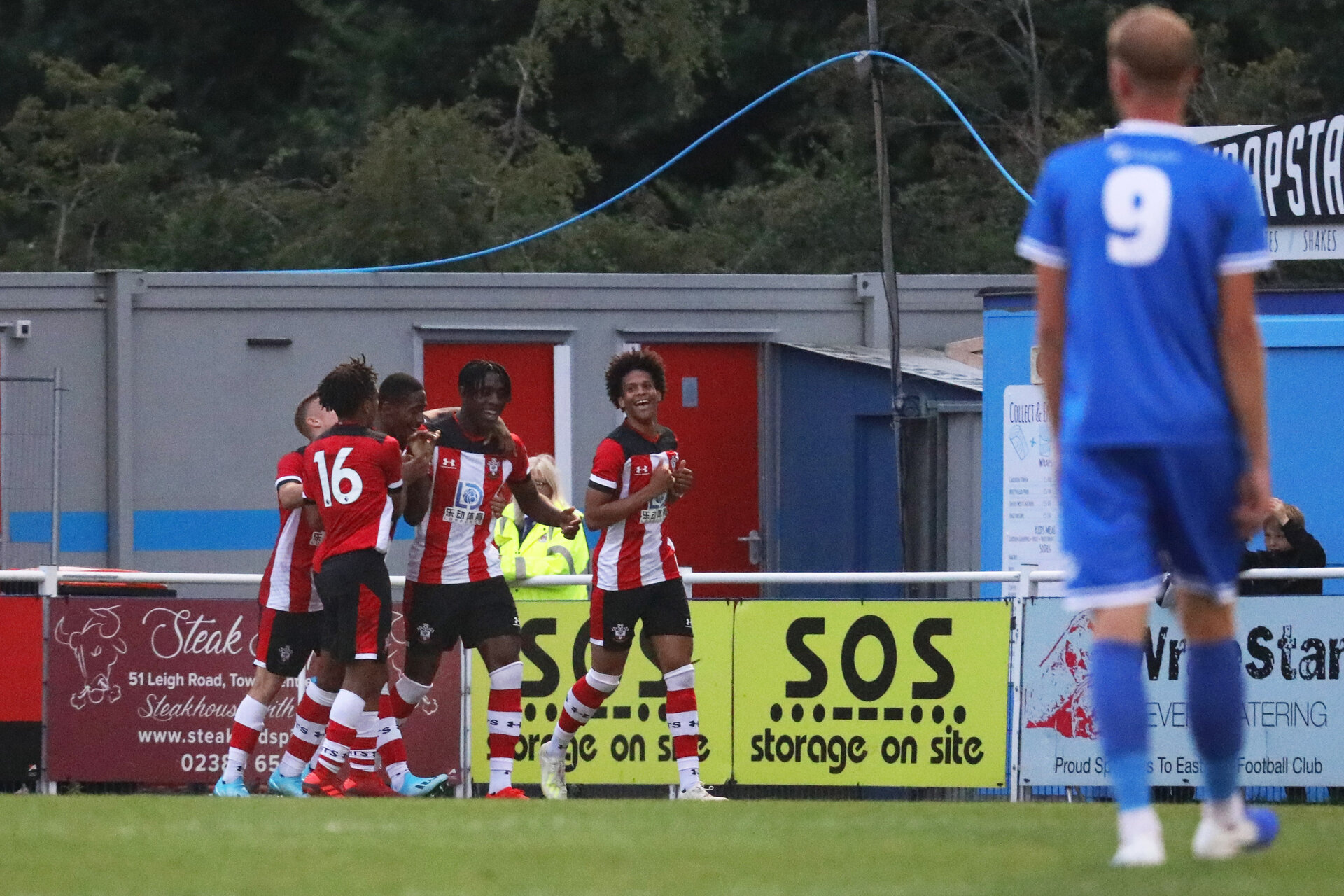EASTLEIGH, ENGLAND, JULY 30: Southampton players celebrate after Dan N'lundulu of Southampton FC scores his side's first goal during the pre-season friendly match between Eastleigh FC and Southampton U23s at Silverlake Stadium, Eastleigh, on Tuesday 30th July, 2019
