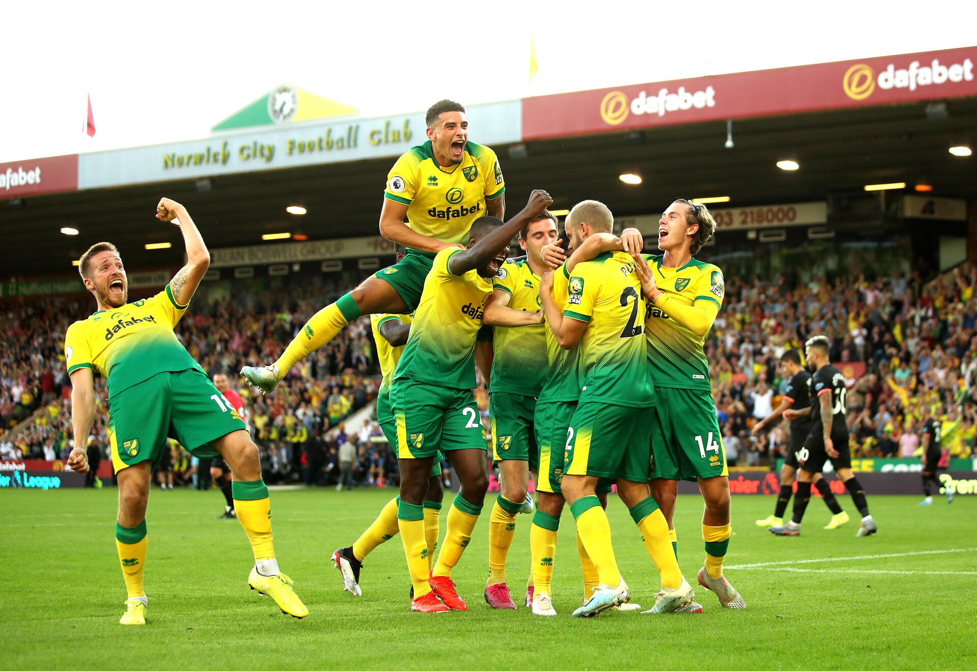 NORWICH, ENGLAND - SEPTEMBER 14: Teemu Pukki of Norwich City celebrates with teammates after scoring his team's third goal during the Premier League match between Norwich City and Manchester City at Carrow Road on September 14, 2019 in Norwich, United Kingdom. (Photo by Marc Atkins/Getty Images)