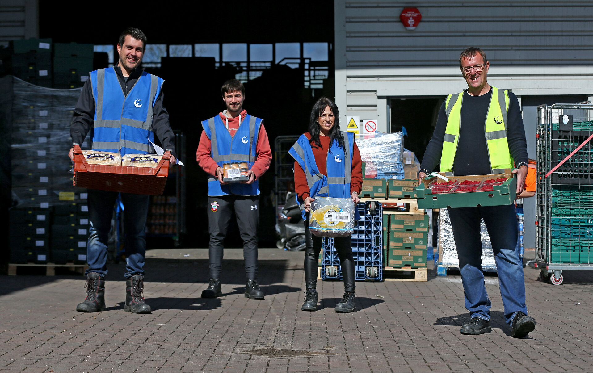 SOUTHAMPTON, ENGLAND - APRIL 06: Former Southampton FC player and current club ambassador Matt Le Tissier(R) volunteers along with Saints foundation staff, at local food distribution centre FareShare, on April 06, 2020 in Southampton, England. (Photo by Matt Watson/Southampton FC via Getty Images)