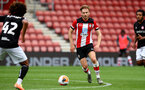 SOUTHAMPTON, ENGLAND - JUNE 12: Stuart Armstrong during a friendly match between Southampton FC and Bristol City, ahead of the Premier League re-start, at St Mary's Stadium on June 12, 2020 in Southampton, England. (Photo by Matt Watson/Southampton FC via Getty Images)