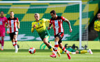 NORWICH, ENGLAND - JUNE 19: (L) Todd Cantwell and (R) Danny Ings during the Premier League match between Norwich City and Southampton FC at Carrow Road on June 19, 2020 in Norwich, United Kingdom. (Photo by Matt Watson/Southampton FC via Getty Images)
