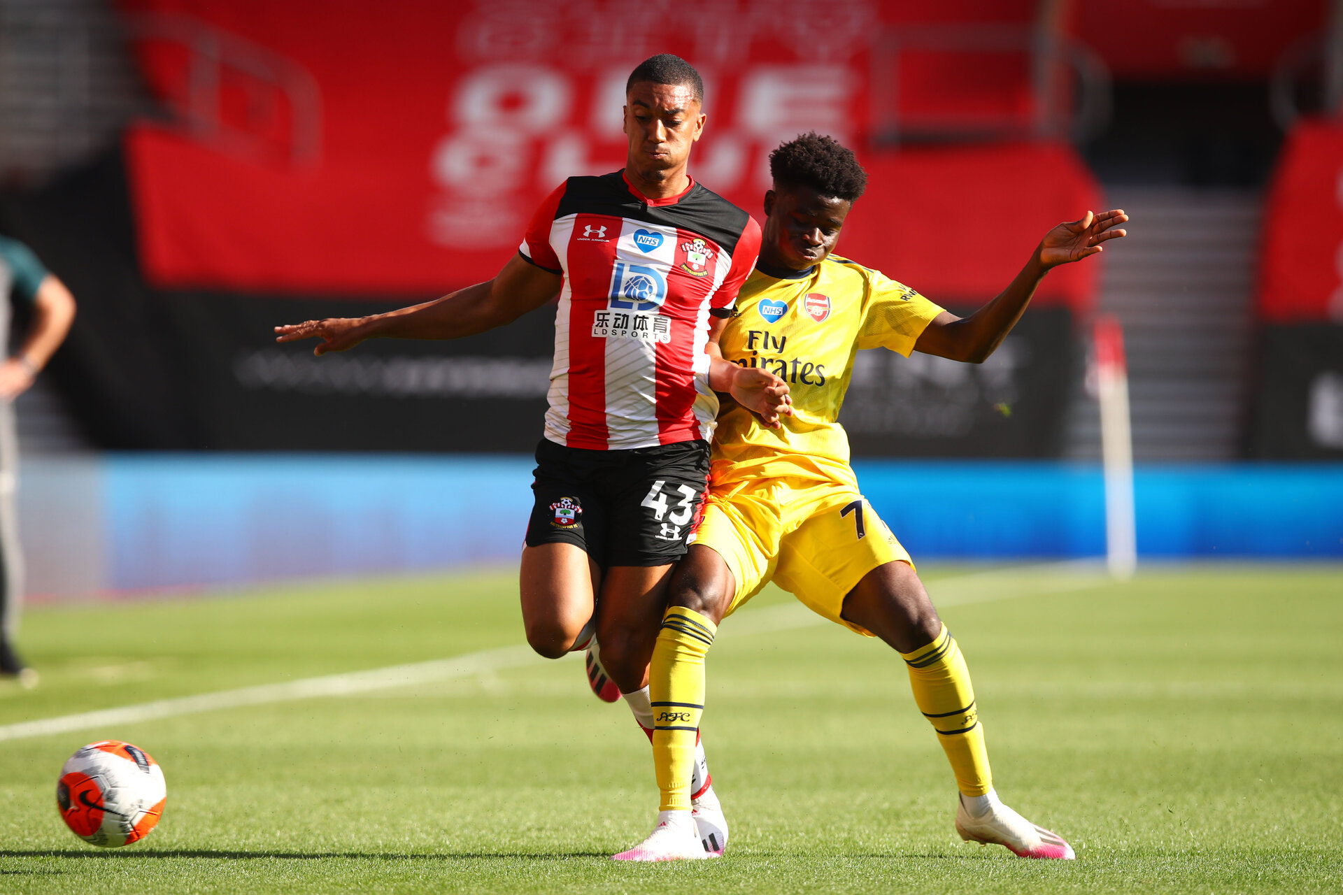 SOUTHAMPTON, ENGLAND - JUNE 25: (L) Yan Valery and (R) Bukoyo Saka during the Premier League match between Southampton FC and Arsenal FC at St Mary's Stadium on March 21, 2020 in Southampton, United Kingdom. (Photo by Matt Watson/Southampton FC via Getty Images)