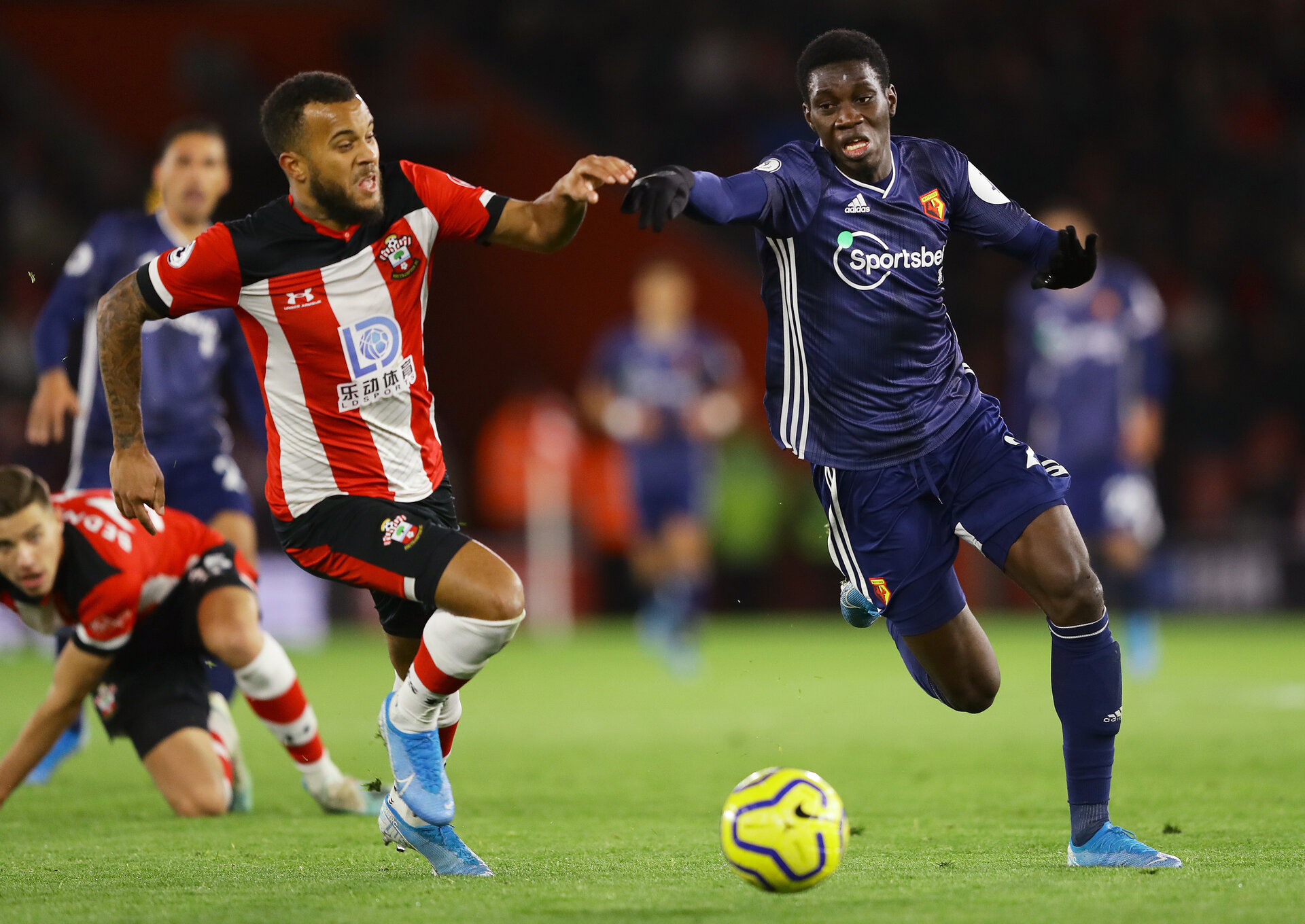 SOUTHAMPTON, ENGLAND - NOVEMBER 30:  Ismaila Sarr of Watford and Ryan Bertrand of Southampton battle for posession during the Premier League match between Southampton FC and Watford FC at St Mary's Stadium on November 30, 2019 in Southampton, United Kingdom. (Photo by Richard Heathcote/Getty Images)