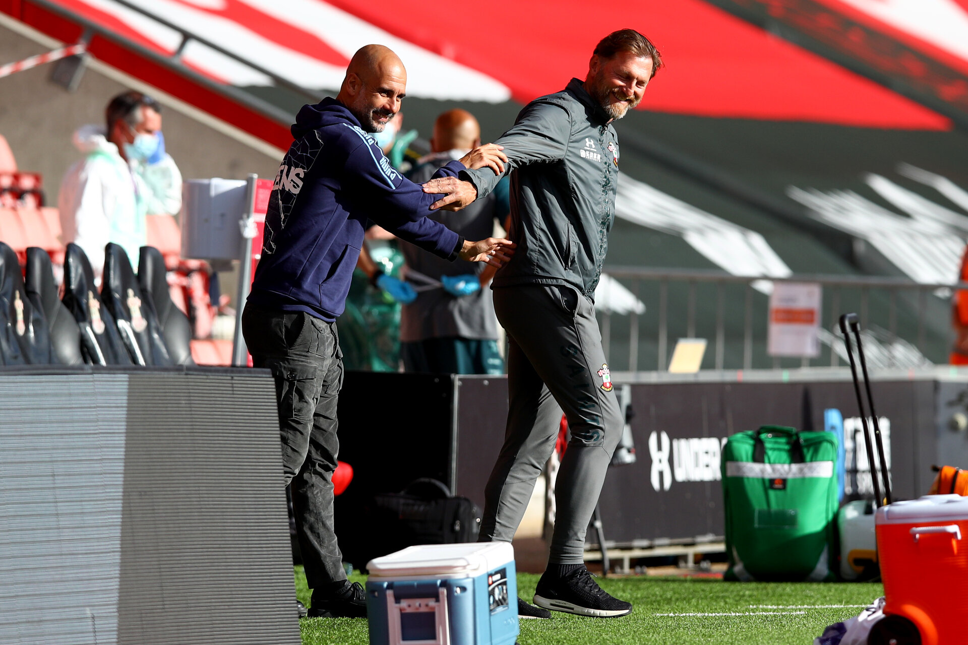 SOUTHAMPTON, ENGLAND - JULY 05: Ralph Hasenhuttl (L) and Pep Guardiola (R) ahead of the Premier League match between Southampton FC and Manchester City at St Mary's Stadium on July 5, 2020 in Southampton, United Kingdom. Football Stadiums around Europe remain empty due to the Coronavirus Pandemic as Government social distancing laws prohibit fans inside venues resulting in games being played behind closed doors. (Photo by Matt Watson/Southampton FC via Getty Images)