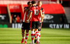 SOUTHAMPTON, ENGLAND - JULY 05: Danny Ings (L), Ché Adams and James Ward-Prowse (R) clebrating Ché Adams goal  during the Premier League match between Southampton FC and Manchester City at St Mary's Stadium on July 5, 2020 in Southampton, United Kingdom. Football Stadiums around Europe remain empty due to the Coronavirus Pandemic as Government social distancing laws prohibit fans inside venues resulting in games being played behind closed doors. (Photo by Matt Watson/Southampton FC via Getty Images)