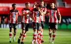 SOUTHAMPTON, ENGLAND - JULY 05: Kyle Walker-Peters (L), James Ward-Prowse, Ché Adams, Jack Stephens and Jan Bednarek (R) clebrating Ché Adams goal  during the Premier League match between Southampton FC and Manchester City at St Mary's Stadium on July 5, 2020 in Southampton, United Kingdom. Football Stadiums around Europe remain empty due to the Coronavirus Pandemic as Government social distancing laws prohibit fans inside venues resulting in games being played behind closed doors. (Photo by Matt Watson/Southampton FC via Getty Images)