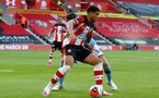 SOUTHAMPTON, ENGLAND - JULY 05: Ché Adams during the Premier League match between Southampton FC and Manchester City at St Mary's Stadium on July 5, 2020 in Southampton, United Kingdom. Football Stadiums around Europe remain empty due to the Coronavirus Pandemic as Government social distancing laws prohibit fans inside venues resulting in games being played behind closed doors. (Photo by Matt Watson/Southampton FC via Getty Images)