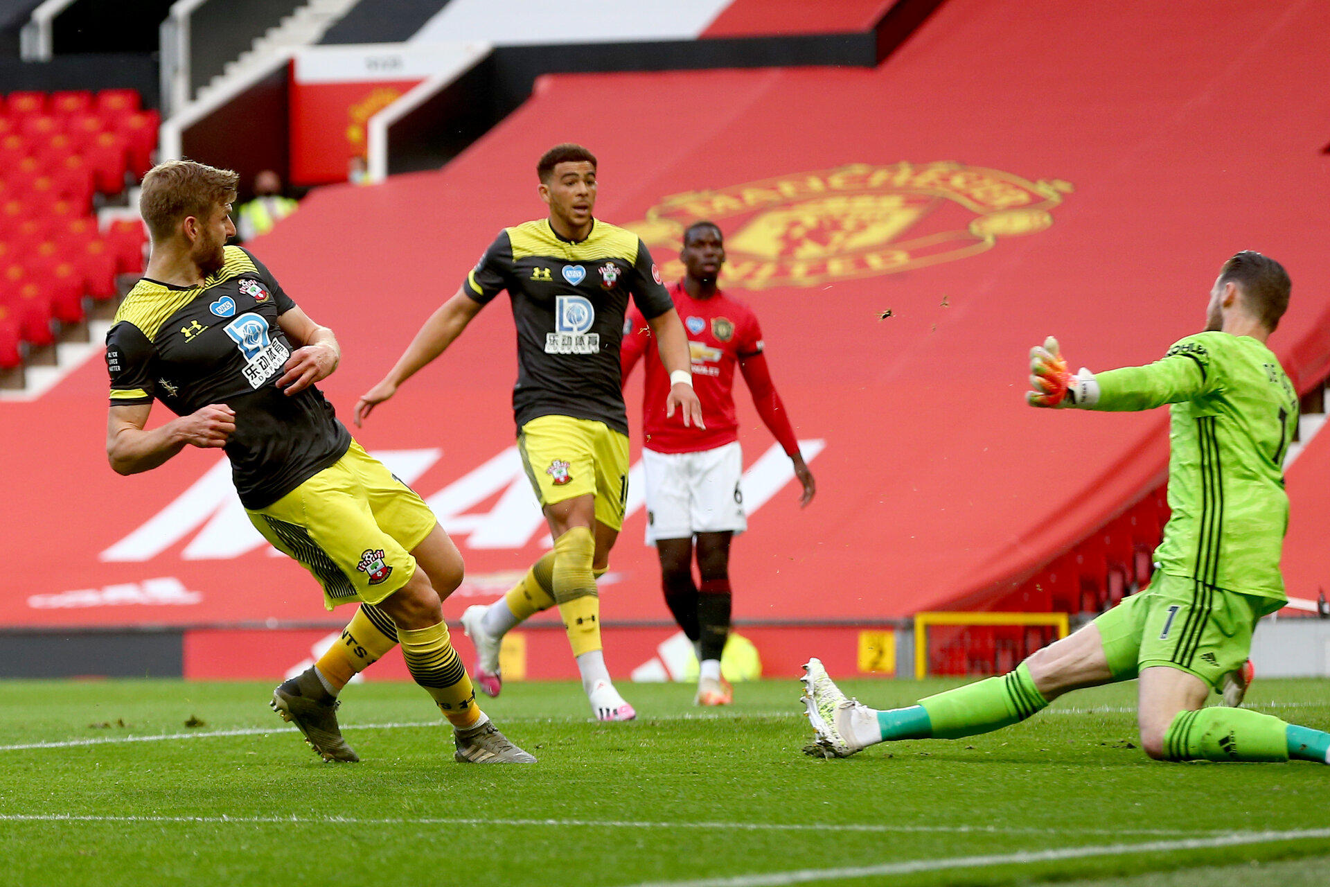 MANCHESTER, ENGLAND - JULY 13: Stuart Armstrong goal during the Premier League match between Manchester United and Southampton FC at Old Trafford on July 13, 2020 in Manchester, United Kingdom. Football Stadiums around Europe remain empty due to the Coronavirus Pandemic as Government social distancing laws prohibit fans inside venues resulting in all fixtures being played behind closed doors. (Photo by Matt Watson/Southampton FC via Getty Images)