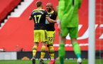 MANCHESTER, ENGLAND - JULY 13: Stuart Armstrong (L) and Nathan Redmond (R) celebrating Stuart Armstrong goal during the Premier League match between Manchester United and Southampton FC at Old Trafford on July 13, 2020 in Manchester, United Kingdom. Football Stadiums around Europe remain empty due to the Coronavirus Pandemic as Government social distancing laws prohibit fans inside venues resulting in all fixtures being played behind closed doors. (Photo by Matt Watson/Southampton FC via Getty Images)
