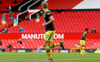 MANCHESTER, ENGLAND - JULY 13: Stuart Armstrong goal celebration during the Premier League match between Manchester United and Southampton FC at Old Trafford on July 13, 2020 in Manchester, United Kingdom. Football Stadiums around Europe remain empty due to the Coronavirus Pandemic as Government social distancing laws prohibit fans inside venues resulting in all fixtures being played behind closed doors. (Photo by Matt Watson/Southampton FC via Getty Images)