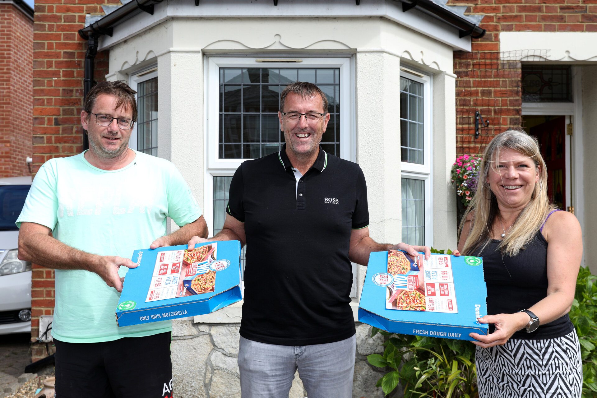 Matt with Paul Hedges and Marion Gealer. Southampton icon and Saints Foundation ambassador Matt le Tissier presented Domino's pizzas to Saints Foundation volunteers Picture: Chris Moorhouse Tuesday 7th July