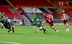 SOUTHAMPTON, ENGLAND - JULY 16: Pierre-Emile Højbjerg of Southampton shoots wide during the Premier League match between Southampton FC and Brighton & Hove Albion at St Mary's Stadium on July 16, 2020 in Southampton, United Kingdom. Football Stadiums around Europe remain empty due to the Coronavirus Pandemic as Government social distancing laws prohibit fans inside venues resulting in all fixtures being played behind closed doors. (Photo by Matt Watson/Southampton FC via Getty Images)