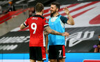 SOUTHAMPTON, ENGLAND - JULY 16: Danny Ings (L) and Shane Long (R) celebrating Danny Ings goal during the Premier League match between Southampton FC and Brighton & Hove Albion at St Mary's Stadium on July 16, 2020 in Southampton, United Kingdom. Football Stadiums around Europe remain empty due to the Coronavirus Pandemic as Government social distancing laws prohibit fans inside venues resulting in all fixtures being played behind closed doors. (Photo by Matt Watson/Southampton FC via Getty Images)