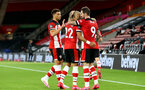 SOUTHAMPTON, ENGLAND - JULY 16: Danny Ings and team mates celebrating his goal during the Premier League match between Southampton FC and Brighton & Hove Albion at St Mary's Stadium on July 16, 2020 in Southampton, United Kingdom. Football Stadiums around Europe remain empty due to the Coronavirus Pandemic as Government social distancing laws prohibit fans inside venues resulting in all fixtures being played behind closed doors. (Photo by Matt Watson/Southampton FC via Getty Images)