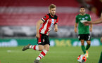 SOUTHAMPTON, ENGLAND - JULY 16: Stuart Armstrong of southampton during the Premier League match between Southampton FC and Brighton & Hove Albion at St Mary's Stadium on July 16, 2020 in Southampton, United Kingdom. Football Stadiums around Europe remain empty due to the Coronavirus Pandemic as Government social distancing laws prohibit fans inside venues resulting in all fixtures being played behind closed doors. (Photo by Chris Moorhouse/Southampton FC via Getty Images)