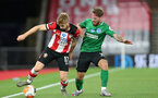 SOUTHAMPTON, ENGLAND - JULY 16: Stuart Armstrong (L) of southampton and Alexis Mac Allister (R) of brighton during the Premier League match between Southampton FC and Brighton & Hove Albion at St Mary's Stadium on July 16, 2020 in Southampton, United Kingdom. Football Stadiums around Europe remain empty due to the Coronavirus Pandemic as Government social distancing laws prohibit fans inside venues resulting in all fixtures being played behind closed doors. (Photo by Chris Moorhouse/Southampton FC via Getty Images)