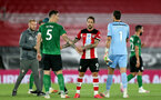 SOUTHAMPTON, ENGLAND - JULY 16: Lewis Dunk (L) of brighton Danny Ings and Alex McCarthy (R)  of southampton during the Premier League match between Southampton FC and Brighton & Hove Albion at St Mary's Stadium on July 16, 2020 in Southampton, United Kingdom. Football Stadiums around Europe remain empty due to the Coronavirus Pandemic as Government social distancing laws prohibit fans inside venues resulting in all fixtures being played behind closed doors. (Photo by Chris Moorhouse/Southampton FC via Getty Images)