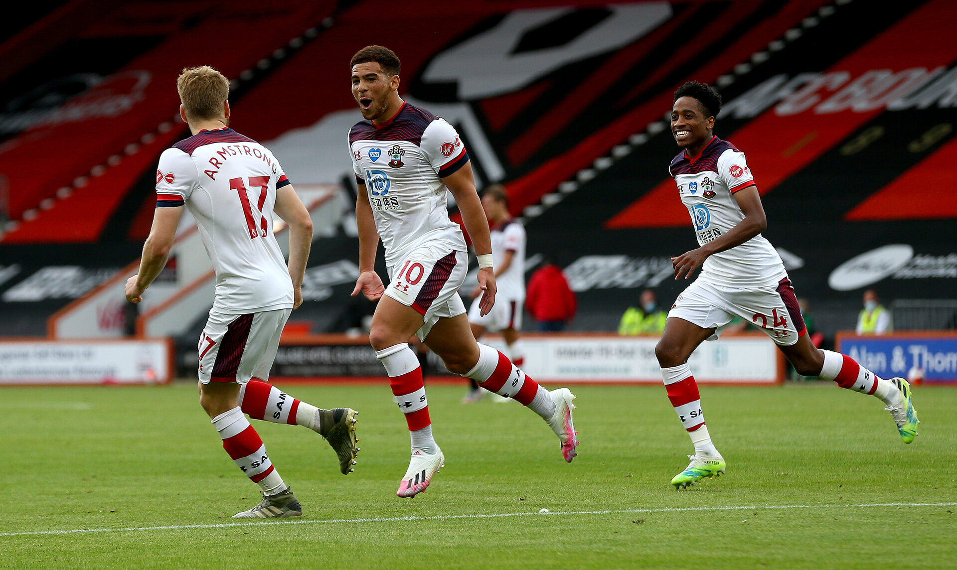 BOURNEMOUTH, ENGLAND - JULY 19: Ché Adams(centre) of Southampton celebrates after scoring during the Premier League match between AFC Bournemouth and Southampton FC at Vitality Stadium on July 19, 2020 in Bournemouth, United Kingdom. Football Stadiums around Europe remain empty due to the Coronavirus Pandemic as Government social distancing laws prohibit fans inside venues resulting in all fixtures being played behind closed doors. (Photo by Matt Watson/Southampton FC via Getty Images)