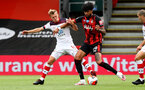 BOURNEMOUTH, ENGLAND - JULY 19: James Ward-Prowse (L) of southampton and Philip Billing (R) of bournemouth during the Premier League match between AFC Bournemouth and Southampton FC at Vitality Stadium on July 19, 2020 in Bournemouth, United Kingdom. Football Stadiums around Europe remain empty due to the Coronavirus Pandemic as Government social distancing laws prohibit fans inside venues resulting in all fixtures being played behind closed doors. (Photo by Matt Watson/Southampton FC via Getty Images)